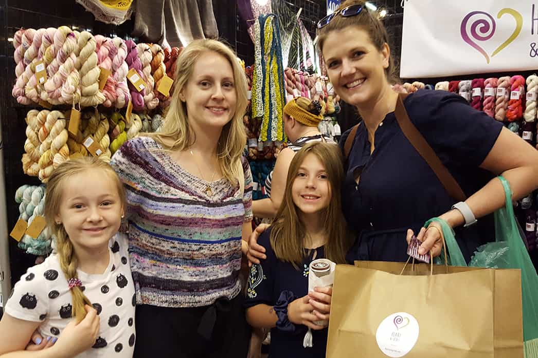 Two women and two girls shopping