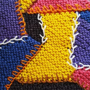 The Knitted Crazy Quilt: A Multi-Craft Adventure